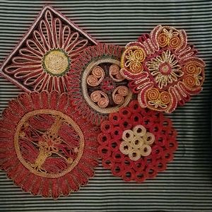 5 vintage woven trivets/wall hanging